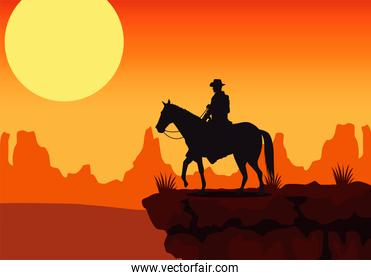 wild west sunset scene with horse and cowboy in the desert