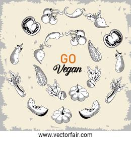 go vegan lettering poster with vegetables around