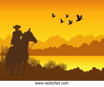 wild west sunset desert scene with cowboy in horse and gulls flying