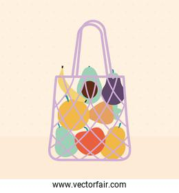 eco bag with a fruits inside of it and purple color on a beige background