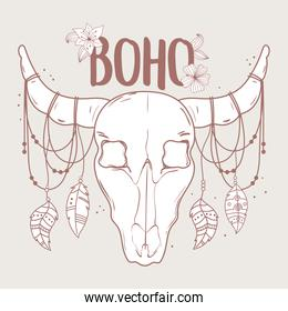 native bull skull with feather and flower boho and tribal