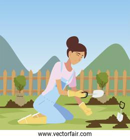 gardening, woman with trowel planting trees
