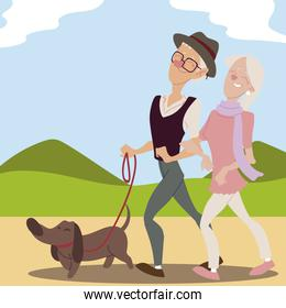 seniors active, old couple walking with dog in park