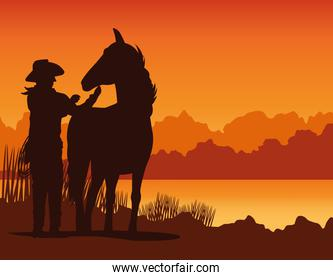 cowboy figure silhouette with horse in the sunset lansdscape scene
