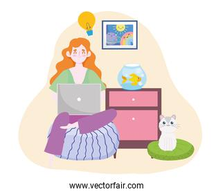 happy woman sitting on sofa with laptop home office