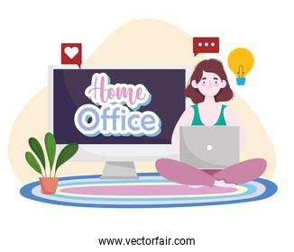 young woman using laptop sitting on floor home office