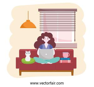 woman working using laptop sitting with books coffee cup and cat home office