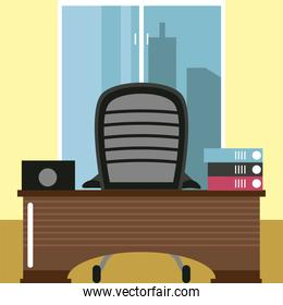 office workspace desk chair binders and laptop