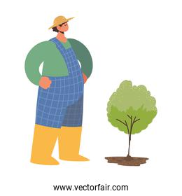 farm and agriculture farmer planting a tree