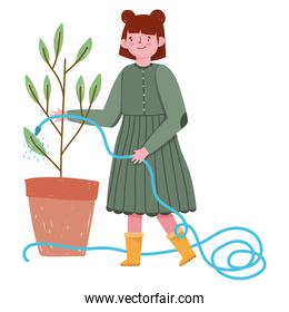 gardening, girl spraying water to a plant with hose