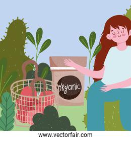 gardening, girl with tomatoes seeds and garden foliage