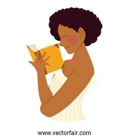 afro american woman reading book in hands