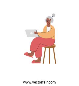 afro old woman using laptop technology character seated in chair
