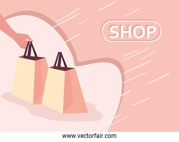 hand with paper shopping bags vector design