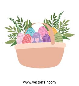 basket full of easter eggs and plants