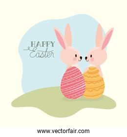 happy easter lettering and rabbits with two easter eggs
