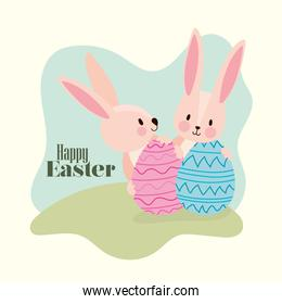 happy easter lettering and two pink rabbits with easter eggs
