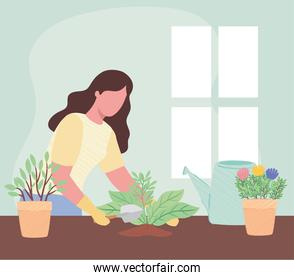 woman with spatule and ghouseplants gardening activity