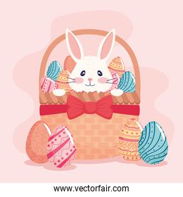 happy easter season card with rabbit and eggs painted in basket