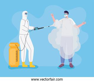 worker wearing bio safety suit disinfecting person