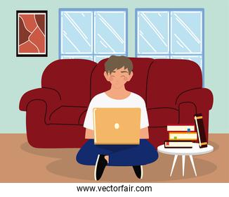 young man using laptop sitting on sofa in the living room, work to home