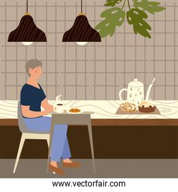 woman with coffee cup croissant sitting at table in coffee shop