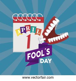 april fools day lettering with joke denture and calendar