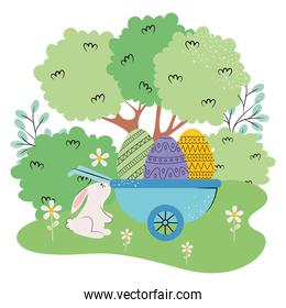 landscape with trees, cute rabbit and wheelbarrow with easter eggs, colorful design