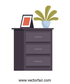 wooden drawer with houseplant and portrait icon