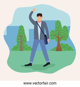 young businessman walking in the park back to office