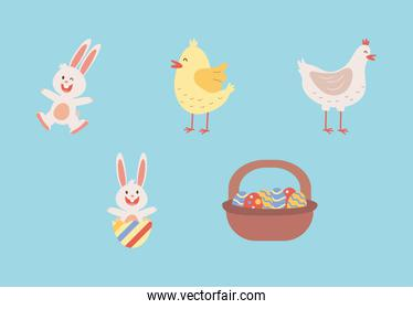 group of easter rabbits with chickens and eggs painted in basket