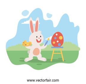 cute little bunny easter painting egg with brush