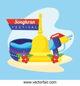 songkran festival celebration lettering with water gun and bowl