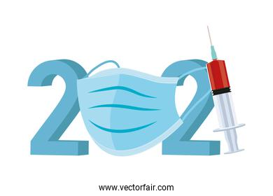 2021 year with covid19 vaccine syringe and medical mask