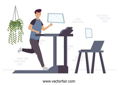 athletic man running in machine with laptop online exercise