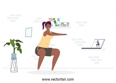 athletic afro woman practicing exercise in the house