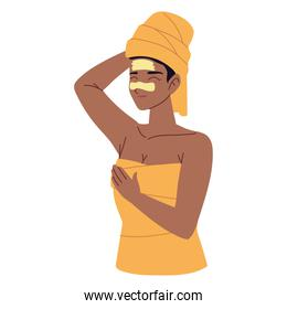 woman with moisturizing lotion on skin wrapped in towel