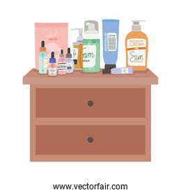 set of skincare icons on a furniture with two drawers