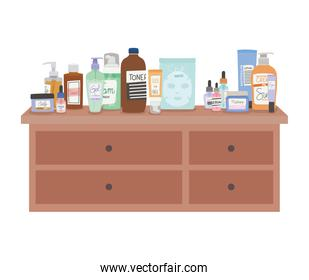 set of skincare icons on furniture with four drawers