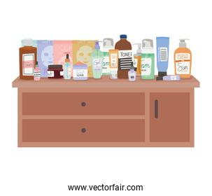 set of skincare icons on furniture with three drawers