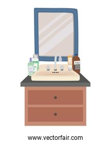 square mirror and set of skincare icons on a furniture with two drawers