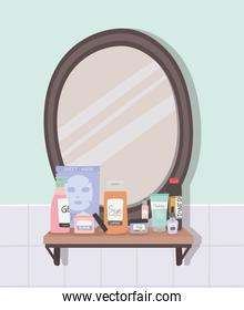 mirror and set of skincare icons on a shelf inside of a bathroom