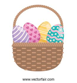 easter eggs painted in basket straw