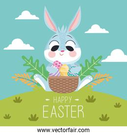 happy easter lettering card with rabbit and eggs in basket in the landscape