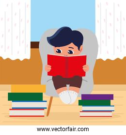 boy reading with books