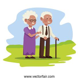 afro grandparents in field