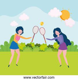 girls playing with rackets