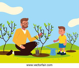 dad and son planting a tree