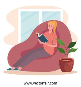 woman reading in couch