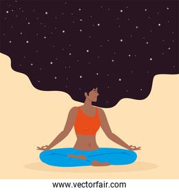 woman sits in lotus position